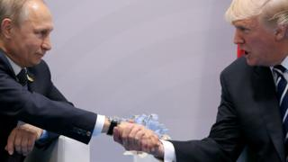 US President Donald Trump shakes hands with Russian President Vladimir Putin during their bilateral meeting at the G20 summit in Hamburg, Germany, July, 2017