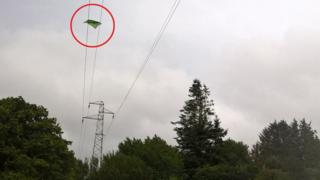 Kite trapped in cables