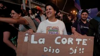 """People celebrate after the Inter-American Court of Human Rights called on Costa Rica and Latin America to recognize equal marriage, in San Jose, Costa Rica, January 9, 2018. The sign reads: """"The court said yes""""."""