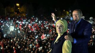 Turkish President Recep Tayyip Erdogan (R) and with his wife Emine (L) waving to supporters during a rally in front of the residence in Istanbul, Turkey, 16 April 2017
