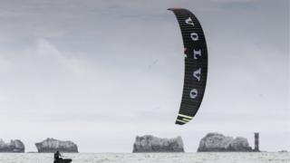 Kitesurfers racing around the Isle of Wight