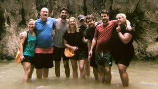 Group standing in water smiling