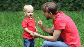 Father speaking to toddler boy