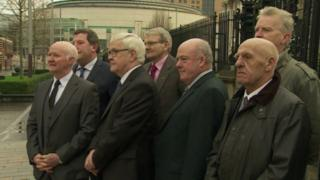 The group known as the 'Hooded Men' spoke to the media outside court along with their legal representatives