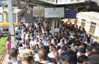 A crowd at a local Mumbai train station