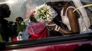 Woman inside wedding gown.