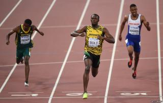 Usain Bolt (C) winning Gold at the World Athletics Championships Beijing 2015