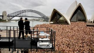 Spencer Tunick photographs a nude crowd in front of the Sydney Opera House in 2010