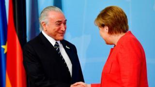 Temer cumprimenta a chanceler alemã, Angela Merkel