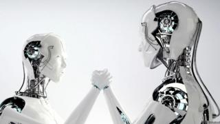 جهازا روبوت يتصافحان