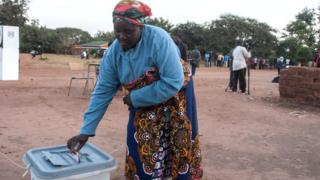 A woman casts her ballot at the Malembo polling station during the presidential elections in Lilongwe on June 23, 2020
