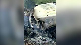 A burnt out car in Mexico, taken from mobile phone footage
