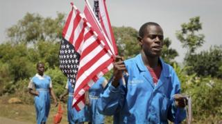 A vendor sells American flags at an event attended by Sarah Obama