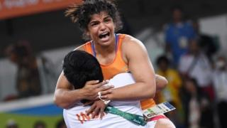 "India""s Sakshi Malik celebrates after winning against Kirghyzstan""s Aisuluu Tynybekova in their women""s 58kg freestyle bronze medal match on August 17, 2016,"