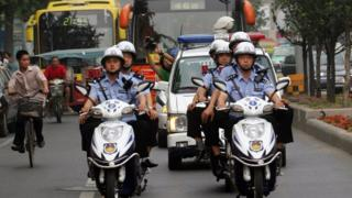 Police patrol on motorcycles in Xian
