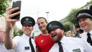 Irish prime minister Leo Varadkar poses for a photo with PSNI officers ahead of the start of the Pride parade in Dublin