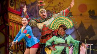 Gemma Sutton, Clive Rowe and Tameka Empson in Aladdin at the Hackney Empire in 2018