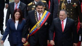 Venezuelan President Nicolas Maduro, his wife Cilia Flores (left) and Venezuelan Assembly President Diosdado Cabello (right) arrive at the National Assembly on 5 July, 2015