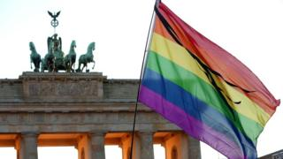 File pic of rainbow flag at Brandenburg Gate in Berlin