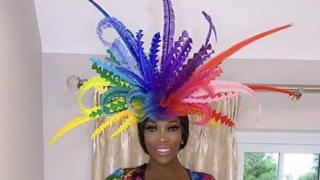 Lystra Adams with a multi-coloured fascinator