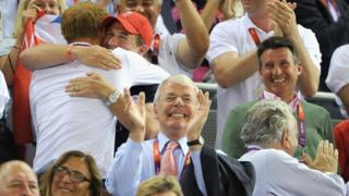 John Major (centre) pictured with Seb Coe (right) and Peter Phillips hugging Prince Harry (left) at the Velodrome in London 2012