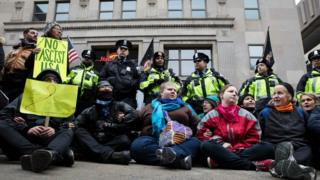 Protesters linked arms in the street on Inauguration Day