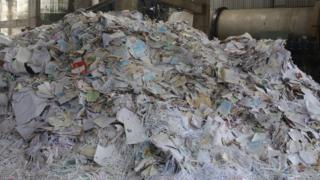 Imported waste paper at a recycling plant in Gujarat