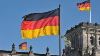 German flags in front of the Reichstag