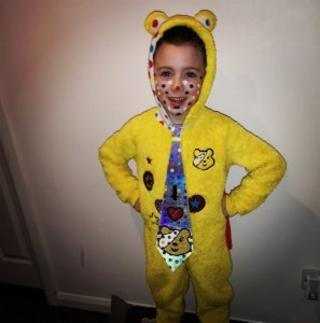 Image of boy in a Pudsey onesie