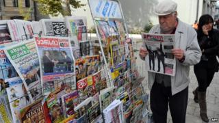 Newspaper reader in Tbilisi