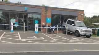 The stolen Land Rover in the window of the Co-operative store in Woodcote