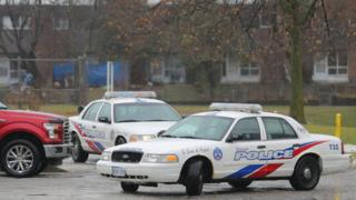 Toronto police cars pictured outside the girl's school