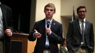 Tyler Ruzich (C), 17, of Prairie Village, Kansas, speaks at a forum.