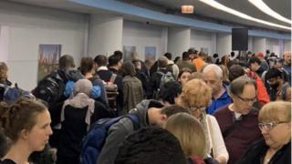 Passengers waiting at O'Hare airport