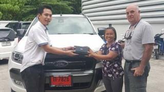 Alan Hogg and his wife Nod Suddaen with a car salesman