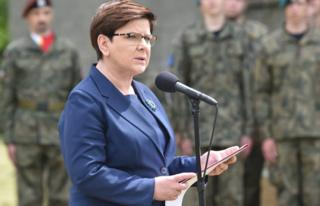 Polish Prime Minister Beata Szydlo speaks next to the Lagerhaus building near the former Nazi-German Concentration camp Auschwitz I in Oswiecim, Poland (14 June 2017)