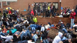 """Protesters take part in a """"die-in"""" at Ithaca College in Ithaca, New York (11 November 2015)"""