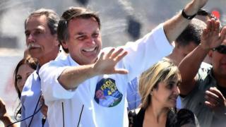 File photo: Jair Bolsonaro gestures during a campaign rally