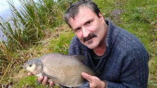 Andrew Price pictured with a fish