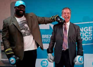 in_pictures Nigel Farage poses with British boxer Dereck Chisora