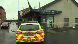 A police car at the scene of the attack outside the Stoker's Halt bar