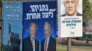 Israeli election billboards in Jerusalem, showing US President Donald Trump (L) shaking hands with Prime Minister Benjamin Netanyahu (2nd L), and Benny Gantz (R)