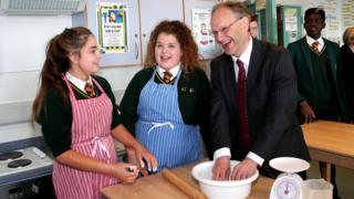Peter Weir talks to pupils at Coláiste Feirste