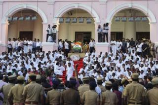 """Body of India""""s Tamil Nadu state former Chief Minister Jayaram Jayalalithaa is wrapped in the national flag and kept for public viewing outside an auditorium in Chennai, India, Tuesday, Dec. 6, 2016."""