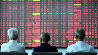Investors stare at trading screen