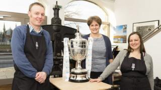 Highland Print Studio staff and artists with Camanachd Cup