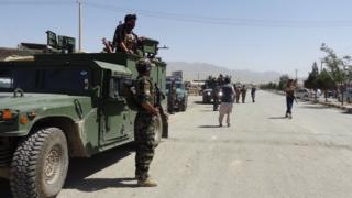 Afghan security officials secure the roads leading to the scene of suicide bomb blasts in Paktia, Afghanistan, 03 August 2018