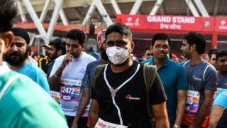 Many participants of the Delhi half marathon wore anti-pollution masks