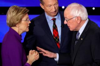 in_pictures US. presidential candidates Senator Elizabeth Warren (D-MA) speaks with Senator Bernie Sanders as billionaire activist Tom Steyer listens after the seventh Democratic 2020 presidential debate at Drake University in Des Moines