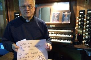Canon Ian Black and damaged church organ